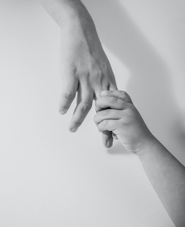 Intergenerational hands together.